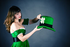 Leprechaun holding his bowler hat Royalty Free Stock Photo