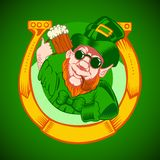 Leprechaun holding a mug of beer in his hand and Stock Image