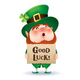 Leprechaun holds a banner with greetings Stock Photo