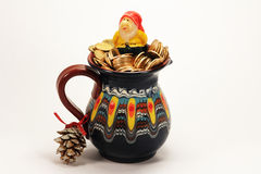 Leprechaun in a jar of gold coins top view. Version of Christmas Royalty Free Stock Image
