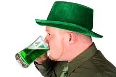 Leprechaun: Man Drinking Green Beer Royalty Free Stock Images