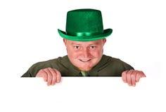 Leprechaun: Man Holding a White Card Royalty Free Stock Photography