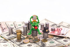 Leprechaun on the pile of money with euro coin Royalty Free Stock Images