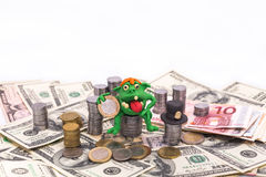 Leprechaun on the pile of money with euro Royalty Free Stock Images