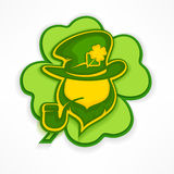 Leprechaun with pipe on green Royalty Free Stock Photo