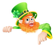 Leprechaun pointing down at sign Royalty Free Stock Photo