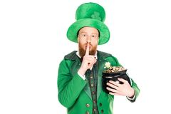 Leprechaun with pot of gold showing silence symbol. Isolated on white Royalty Free Stock Images