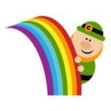 Leprechaun and Rainbow. Funny cartoon leprechaun peeks out from the rainbow Stock Photo