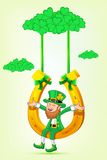 Leprechaun sitting on horse shoe swing Stock Images