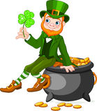 Leprechaun sitting on pot of gold Royalty Free Stock Image