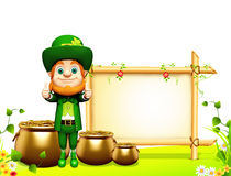 Leprechaun stands near sign for patrick day Stock Photography