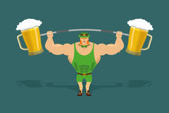 Leprechaun is strong. Powerful leprechaun and barbell with mugs Stock Image