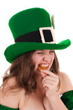 Leprechaun to trying a gold coin on the tooth Stock Images