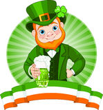 Leprechaun Toast. Leprechaun Raises A Glass To Celebrate St. Patricks Day Royalty Free Stock Photography