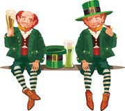 Leprechauns drinking beer Stock Images