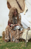 Leprous woman. Nogent le Rotrou,France,May,16th,2010: An actor woman wearing a specific costume and make-up for leprous people in the medieval ages, during the Stock Photography