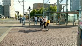People pass the road on a pedestrian and cycling passage. stock video footage