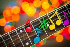 Leraanmärkningar på rader av gitarren Fotografering för Bildbyråer