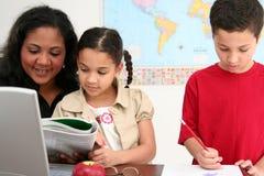 Leraar en Studenten stock foto's