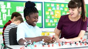 Leraar And Pupil Using Moleculair Modelkit in science lesson stock footage