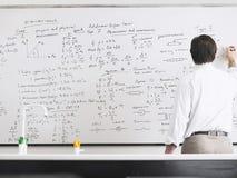 Leraar Writing On Whiteboard stock fotografie
