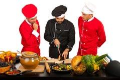 Leraarschef-kok met studenten Stock Afbeeldingen