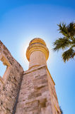Lerapetra Turkish Mosque Mineret. Turkish mosque mineret eclipses the sun in the town of Lerapetra on the Greek island of Crete Royalty Free Stock Images