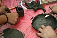 lerastöpning för 3 barn Arkivbilder