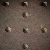 Lerciume di Brown di piastra metallica o struttura dell'armatura con i ribattini Fotografia Stock