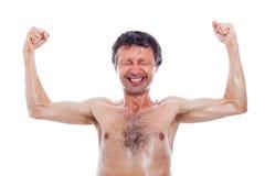 Lerdo engraçado que mostra os músculos imagem de stock