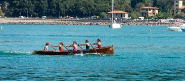 Female Rowing Team of Lerici - La Spezia Italy. LERICI, LA SPEZIA, LIGURIA, ITALY, JULY 19, 2014: The female rowing team of Lerici trains in the waters of the royalty free stock photo