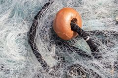 Fishing net and float in the harbour in Lerici Liguria Italy on April 21, 2019. LERICI, LIGURIA/ITALY  - APRIL 21 : Fishing net and float in the harbour in royalty free stock photos
