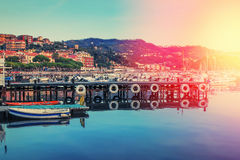 Lerici at susnet, Ligurian province, Italy. Pier and boats in the harbor of Lerici at sunset, Ligurian province, Italy. Color filter applied Royalty Free Stock Photography