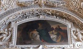 les 14èmes stations de la croix, Jésus est étendues dans la tombe et couvertes dans l'encens Photographie stock