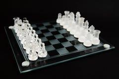 Les échecs en verre - jouons Photos stock
