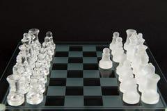 Les échecs en verre - jouons Images libres de droits