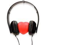 Les écouteurs de concept avec amour Image stock