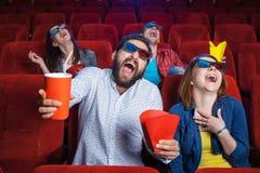 Les émotions des personnes dans le cinéma Images libres de droits