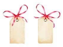 Les étiquettes vides de cadeau d'aquarelle avec le ruban rouge cintre Image stock