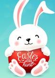 Les étreintes de lapin de Pâques egg avec la citation de salutation de vacances Chasse à oeuf de pâques Image libre de droits