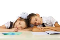 Les étudiants dorment sur le bureau Image libre de droits