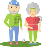les aînés couplent jouer le badminton Photo stock