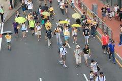Les activistes 2015 de Hong Kong marchent en avant du vote sur le paquet électoral Photo stock