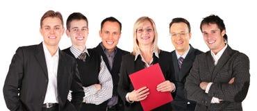 les affaires font face au sourire de gens de groupe Image libre de droits