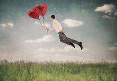 Les aides d'amour à voler vers le haut Images stock