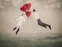 Les aides d'amour à voler vers le haut Image stock