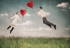 Les aides d'amour à voler vers le haut Photographie stock