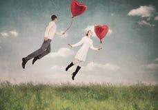 Les aides d'amour à voler vers le haut Photographie stock libre de droits