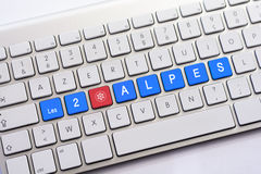 LES 2 ALPES writing on white keyboard with a snowflake sketch Royalty Free Stock Photo