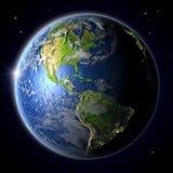 Les Amériques de l'espace pendant le coucher du soleil Photo stock